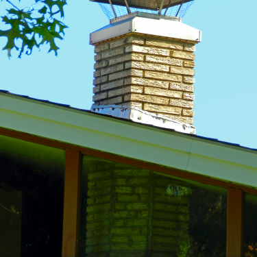 Look at how the chimney is set on a 45 degree angle but when it enters the house it's actually octagonal!