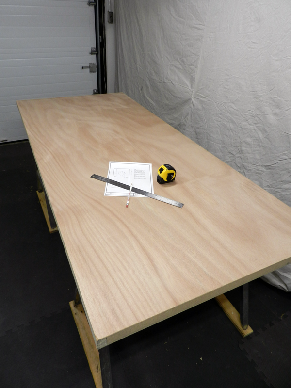 Lay your door slab flat on sawhorses so that you will be able to cut out your opening(s).