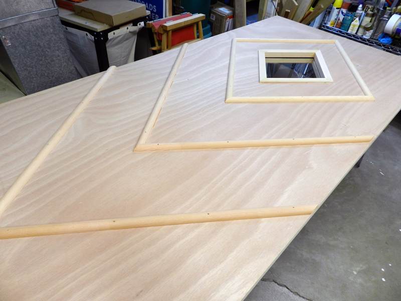 Lay out your moldings per your measured marks before you fasten them down.
