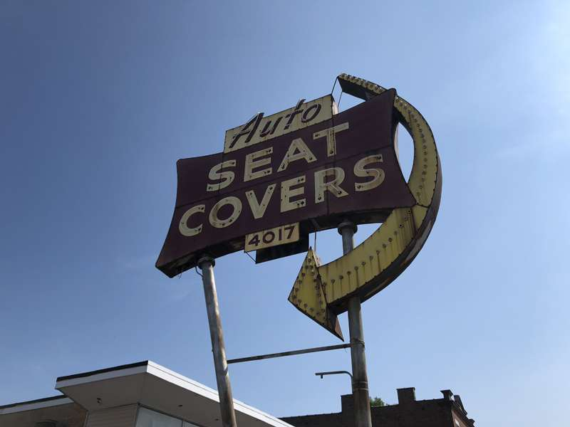 The Auto Seat Covers sign in St. Louis.