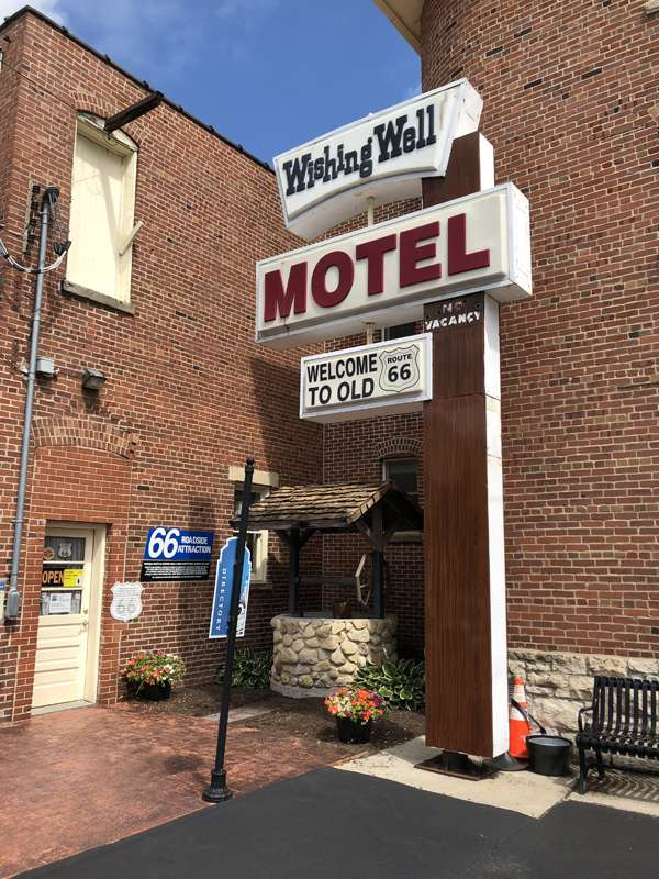 The old Wishing Well Motel sign and well in the back of the museum.