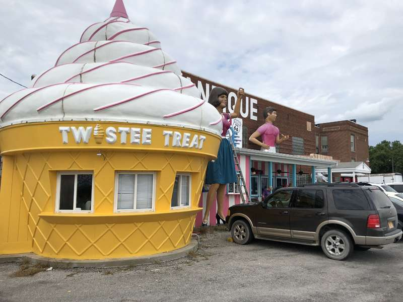 Ice cream booth and giant people at the antique mall.