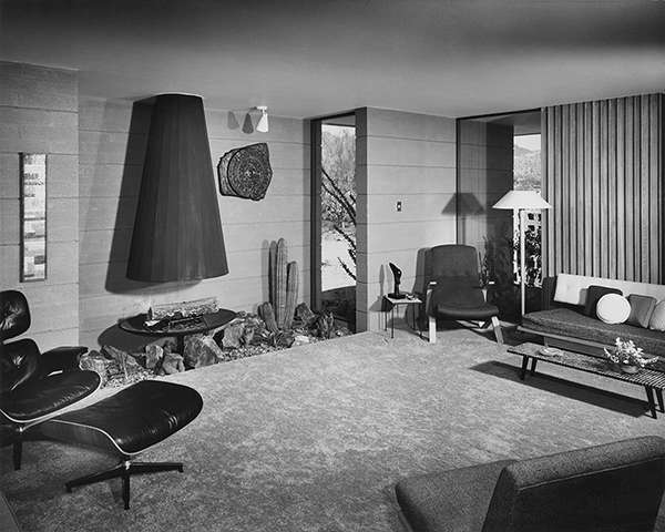 The living room in the second Fingado house showing the semi-conical fireplace. (5)