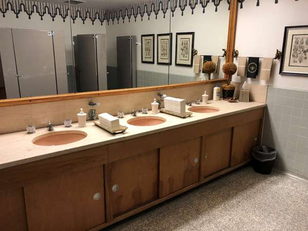 Original women's room sinks and cabinets