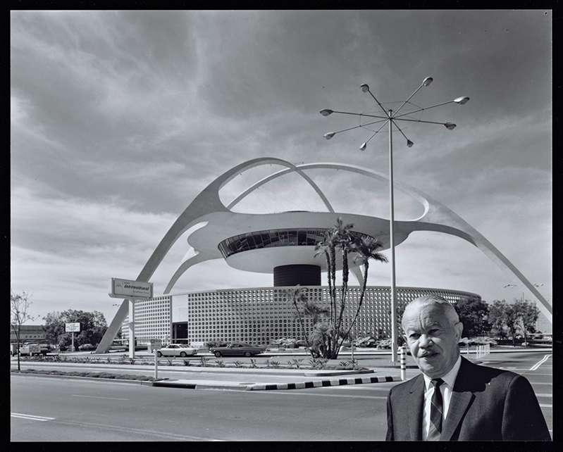 Julius Shulman's photograph of William in front of the theme building at LAX